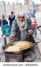 PESHAWAR, PAKISTAN,  ?July ?27, ?2015:  vendors selling halwa sweet  in Peshawar, Pakistan.