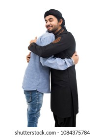 Peshawar, Pakistani, Indian Faithful Muslims hug with each other after Eid-ul-Fitar prayer, Muslim Arabic brothers meeting together with father,Muslim man hugging and wishing to each other on occasion