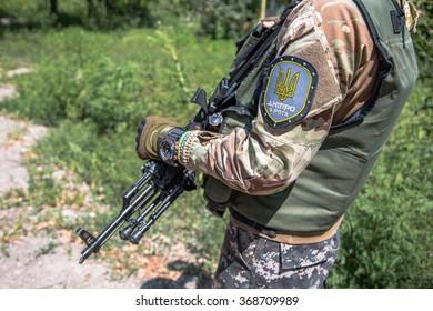 PESKY VILLAGE NEAR DONETSK CITY, UKRAINE July 28, 2015: Ukrainian soldiers on patrol