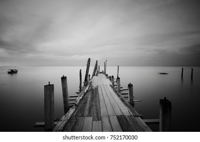 pespective view of old jetty in black and white format. soft focus due to long exposure.