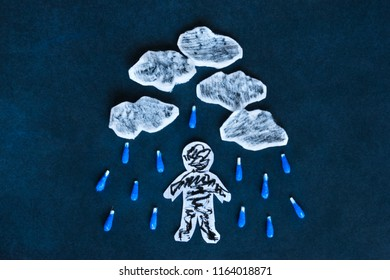 Pessimism and depression concept, paper man under the rainy sky on he dark background.