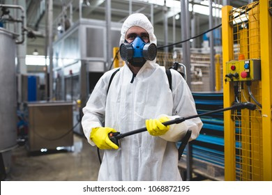 Pest Control Worker Hand Holding Sprayer For Spraying Pesticides in production or manufacturing factory