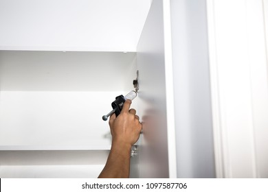 Pest Control Worker Spraying Pesticide inside the house