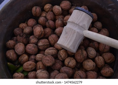 An pestle with raw nuts.
