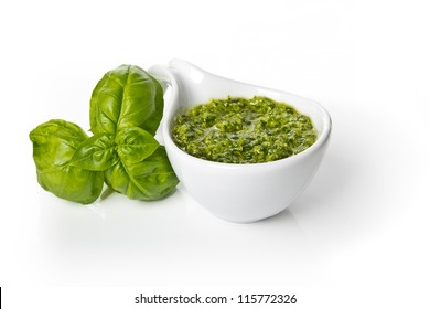 Pesto Genovese in a gravy boat and basil