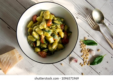 Pesto Gnocchi with courgette and tomato flat lay with