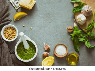 Pesto ingredients background with a space for a text, view from high angle