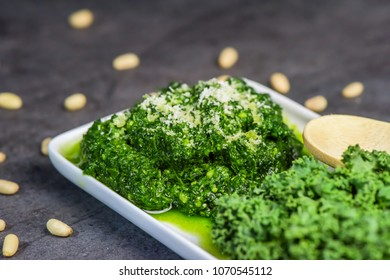 Pesto made from kale, cheese grana padano, lime, pine nuts and garlic - close up
