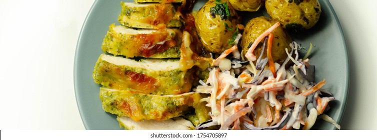 Pesto and mozzarella chicken breast fillet with herby baby potatoes and creamy coleslaw salad, delicious dish