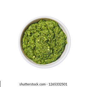 Pesto sauce in bowl isolated on white background. Portion of pesto sauce.