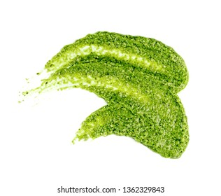 Pesto spread or blob isolated on white background. Green italian homemade spilled sauce made of ground basil, garlic, pine seeds, olives and pecorino sardo cheese top view