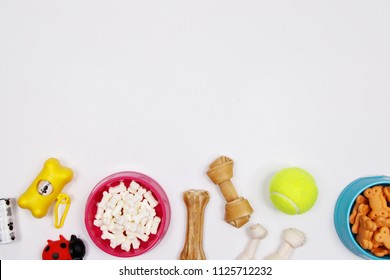 Pet accessories, food and toy on white background. Flat lay. Top view.