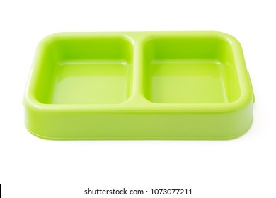 Pet bowls - Empty plastic green feeder pet bowls for Dogs Cats and Pets isolated on a white background with natural shadow and include clipping path.