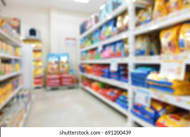 Pet food package on shelf in shop feed or Pet food store, abstract blurred background