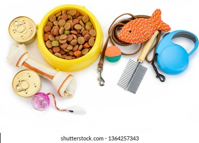 Pet food, toys and accessories on white background. top view. Best products for cats and dogs of all life stages.