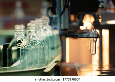 PET Preform in PET bottles blow molding machine in factory. Technology in plastic bottles machine for industry. Industrial and factory concept.