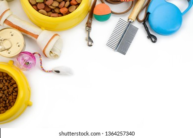 Pet supplies on white background with copy space. Food, treats, toys, grooming brush and leash for cats and dogs.