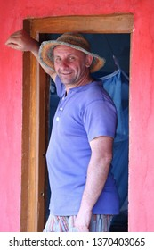 Peta, India – February 28, 2019: Portrait of an European farmer in a red door