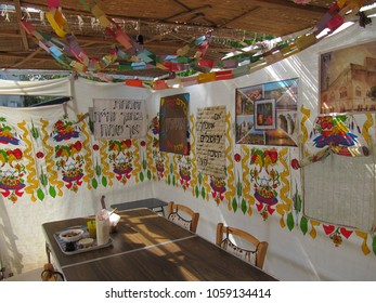 Petach Tikva, Israel - Oct 8, 2009: Sukkah with decorated cloth walls