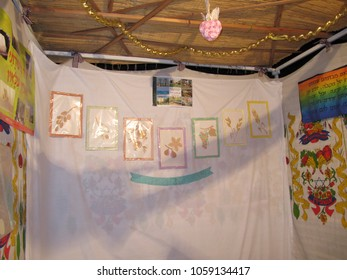 Petach Tikva, Israel - Oct 8, 2009: Sukkah with decorated cloth walls, the main wall bearing pictures of the seven species the Land of Israel was blessed with