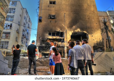 Petah Tikva, Tel Aviv, Israel May 14, 2021:  People observe the destruction, ruins and destroyed houses and cars due to rockets attack launched from Gaza during Operation Guardian of the Walls