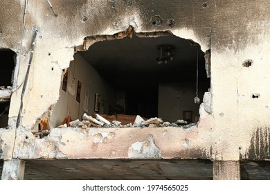 Petah Tikva, Tel Aviv, Israel May 14, 2021:  destruction of houses due to rockets attack launched from Gaza during Operation Guardian of the Walls - huge hole in Israeli living room