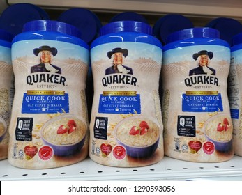 petaling jaya - Malaysia, 21 January 2019: healthy oat quick cook from quaker brand in big bottles packaging display in supermarket for sell