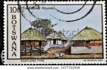 PETALING JAYA, MALAYSIA- AUG 2019: A STAMP PRINTED BY BOTSWANA SHOWING TRADITIONAL HOUSES, KGATLENG TYPE, VB MOREMI, CIRCA 1982