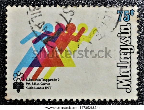 "PETALING JAYA, MALAYSIA- AUG 2019: A STAMP PRINTED BY MALAYSIA SHOWING ""9TH. S.E.A. GAMES KUALA LUMPUR 1977 (SUKAN ASIA TENGGARA KE 9 KUALA LUMPUR 1977)"", 75 CENTS, CIRCA 1977"