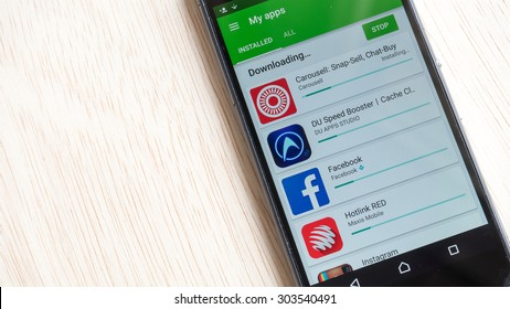 Petaling Jaya, Malaysia - Aug 6, 2015: Android apps updates via Google Play Store on smartphone. Google Play, originally the Android Market, is a digital distribution platform operated by Google