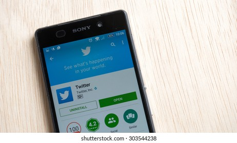 Petaling Jaya, Malaysia - Aug 6, 2015: Twitter mobile app in Google Play Store on mobile phone. Twitter has mobile apps for iPhone, iPad, Android, Windows Phone, BlackBerry, Firefox OS, and Nokia S40.