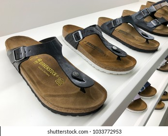 PETALING JAYA, MALAYSIA - FEBRUARY 24, 2018 - Birkenstock sandals displayed in shoe store. German brand of sandals and other shoes notable for their contoured cork and rubber footwear.