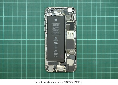PETALING JAYA, MALAYSIA - JANUARY 25, 2018: Close up view of Apple iPhone internal parts, compartment and battery. iPhone tear down.