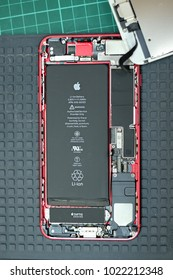PETALING JAYA, MALAYSIA - JANUARY 25, 2018: Close up view of Apple iPhone internal parts, compartment and battery. iPhone teardown.