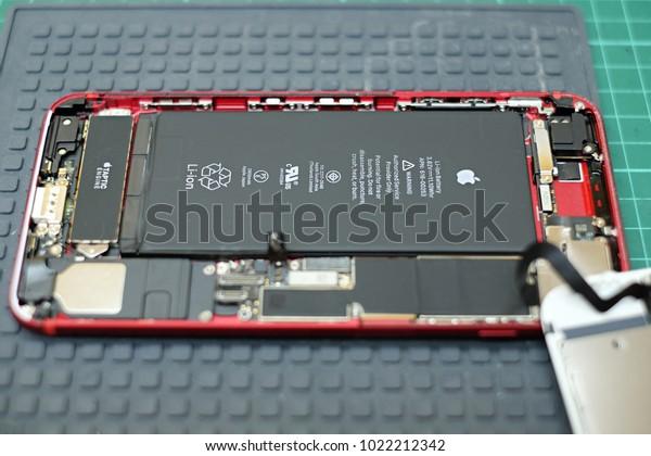 PETALING JAYA, MALAYSIA - JANUARY 25, 2018: Close up view of Apple iPhone internal parts, compartment and battery. iPhone teardown.