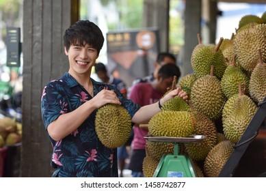 Petaling Jaya, Malaysia - July 18, 2018 : Tourists enjoying durian (king of fruit) at street Durian Man Stall at Petaling Jaya.