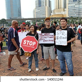 PETALING JAYA, MALAYSIA - MAY 25: Malaysian youth with political placard at a protest rally against alleged fraudulent 13th general election on May 25, 2013 in Padang Timur, Petaling Jaya, Malaysia.