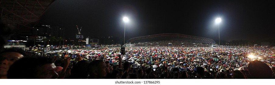 PETALING JAYA, MALAYSIA - MAY 8: Malaysians at a political rally against the fraudulent Malaysia 13th general election vote result on May 8, 2013 in Stadium MBPJ, Petaling Jaya, Malaysia.