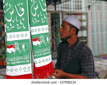PETALING JAYA, MALAYSIA - MAY 8: Vendor with Islamic political memento at a political rally against Malaysia 13th general election vote result on May 8, 2013 in Stadium MBPJ, Petaling Jaya, Malaysia.