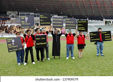 PETALING JAYA, MALAYSIA - MAY 8: Protester with political placard at a political rally against the Malaysia 13th general election vote result on May 8, 2013 in Stadium MBPJ, Petaling Jaya, Malaysia.