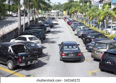 PETALING JAYA, SELANGOR - JUNE 20: Parking site are full during working hours at Petaling Jaya, Selangor, near Kuala Lumpur, Malaysia on June 20, 2013.
