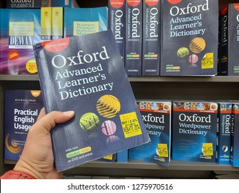 Petaling Jaya, Selangor, malaysia - 06 December 2018 : a man holding a dictionary book with his hand in a popular bookstore. the dictionary is publish by OXFORD