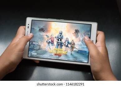 petaling jaya, selangor, malaysia - 31 July  2018 : boy holding a digital tablet playing online mobile game called PUBG, a famous online shooting games between kids and teenagers