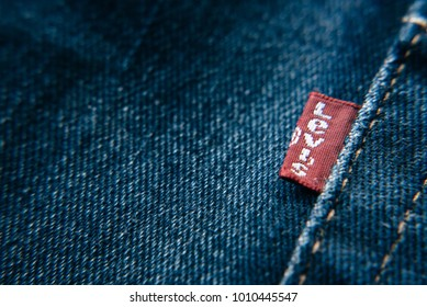 Petaling Jaya,Selangor,Malaysia - Jan 24th 2018 : closeup detail of levi's red tag on levi's jeans. Levi Strauss is a famous American clothing company