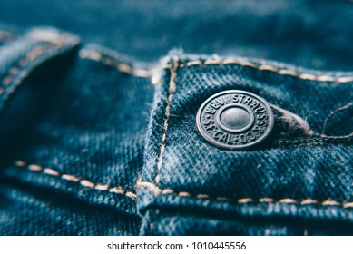 Petaling Jaya,Selangor,Malaysia - Jan 24th 2018 : closeup of Levi's jeans button. Levi Strauss is a famous American clothing company.