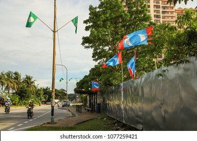 Petaling Malaysia Apr 25, 2018. Party flags put up along the streets of the suburb Petaling in conjunction of impending general election, flags up on lamp post