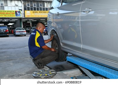 Petaling, Malaysia,July 26,2017 Mechanic removing tire from the rim, machine used to remove and fixing the car tires,
