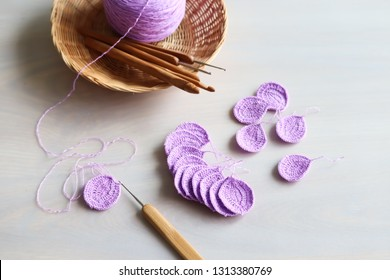 Petals purple crochet flower and wood crochet needles.