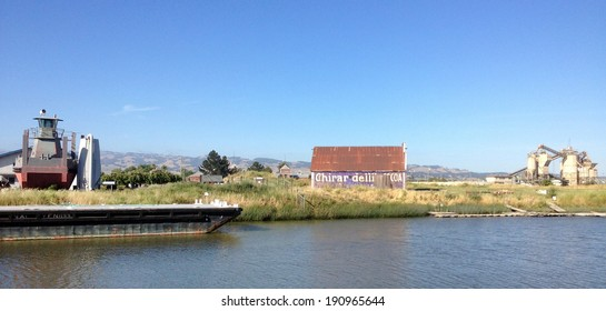 PETALUMA, CALIFORNIA - MAY 5, 2013 -- A barn with a Ghirardelli advertisement remains enshrined in history along the Petaluma River, part of San Francisco Bay in Sonoma County.