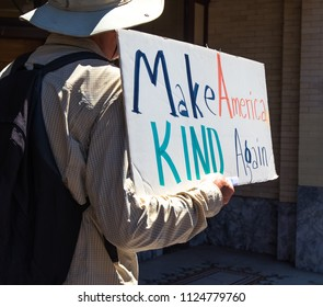 Petaluma, CA/USA-June 30, 2018: Man hold sign about keeping America kind during Keep Families Together March
